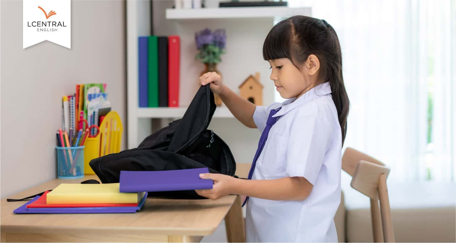 The child packing her bag and getting ready for primary school